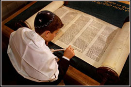 Photograph of boy reading Torah